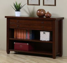 Give any room in the home added functionality and a modern update with this sleek two-drawer cherry console table. This table will help put an end to clutter by giving you two shelves and two slim-style drawers for storing your belongings out of sight.