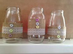 Home made, cheap, Very simple ideas for centre pieces using old jam jars, hessian, lace & buttons. Ideal for a spring wedding