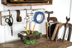 Clamp bookeend organizers and gear pencil holder / A rusty tool themed work station for organizing tools and office gear / funkyjunkinteriors.net