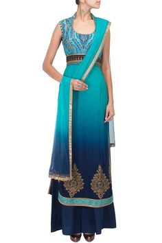 Featuring a turquoise to midnight blue ombre kurta with digitally printed hand embroidered cotton silk bodice and zari floral motifs on border. It has an empire