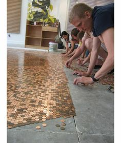 Penny floors?  Penny walls?  1.44 a sq foot, unique but labor intensive.   Not sure if it's considered defacing money, but........