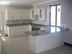 This elegant kitchen in soft sand tones compliments the granite tops and has a nice and airy flow Room Door Design, Kitchen Room Design, Home Decor Kitchen, Interior Design Kitchen, Living Room Corner Furniture, Classy Living Room, Modern Kitchen Cabinets, Granite Kitchen, Diy Kitchen Storage