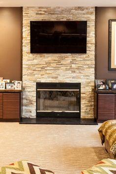 Split Rock Fireplace Full Wall -Contemporary family room. http://www.kmrenovate.com