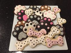 Dog decorated sugar cookies for humans. Royal icing. Brown, chocolate, pink, white. Dog paw, dog bone. PugHearts Pug Rescue of Houston.