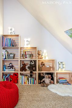 "Nothing creates a winding-down tone quite like mood lighting. This blogger used plain crates and letter lights that spell out ""read"" to create a nook that will prove to kids reading is cool. See more at Maison de Pax »"