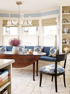 Blue and tan banquette with a drop-leaf table.