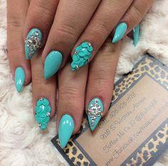 Aqua blue stiletto nails. I love the 3D flowers. Very pretty