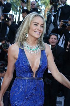 Sharon Stone at the Cannes Film Festival premiere of 'Behind the Candelabra' in May 2013 wearing a de GRISOGONO High Jewellery white gold necklace with seven cabochon emeralds and white diamonds.