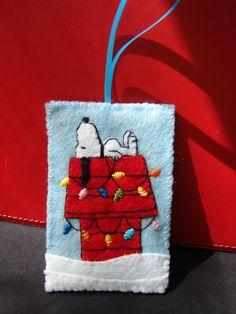 This is a Snoopy ornament done in felt, which is flat. Perfect as a gift to fit in a card. Size is approx. 2 x 3.    All handcut, hand stitched. Check