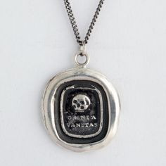 Pyrrha Skull Talisman Necklace $166    This handcrafted wax seal necklace reads Omnia Vanitas which means All Is Emptiness. The skull pictured is a reminder of the transient nature of material things.