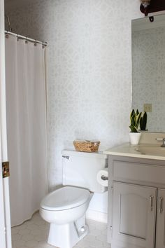 Bathroom makeover with stenciled walls (plus enter to win a $50 shopping spree to Royal Design Studio!).