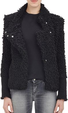 IRO black boucle jacket styled with convertible notched lapels. Rib-knit cuffs. Snap buttons at front.