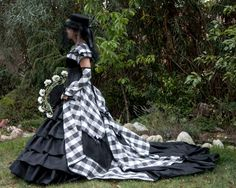 Black, white and grey checkered dress. Stylized for alternative wedding dress, comes together with black leather corset.  Size: S/M Waist: 28 (71 cm)  Set includes: -Corset  Leather, underburst corset. Sewn by hand. Tied at the back. Black -Blouse with a collar -Black underskirt with frills -Checkered train -Gloves