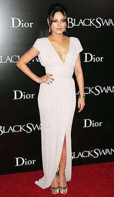 November 30, 2010 At the NYC premiere of Black Swan, Kunis took a risk in a plunging Elie Saab gown.
