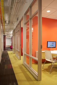 nice glass office walls, colors, exposed ceilings
