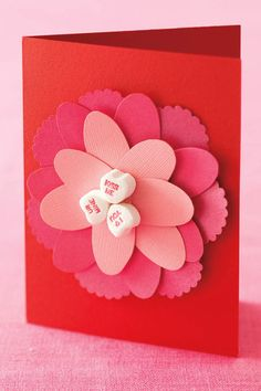 Cut-Paper Flower Card: Help your little ones make their very own Valentine's Day cards with a candy heart center. Click through to find more easy and simple Valentine's Day crafts to make with your kids.