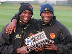 Trinidad and Tobago's Dwight Yorke (left) lifts his January 1999 award with United strike partner Andy Cole