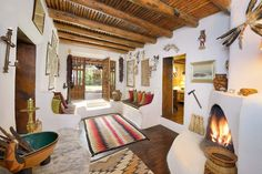 Eclectic adobe hacienda filled with Southwestern art asks $4.5M - Curbed