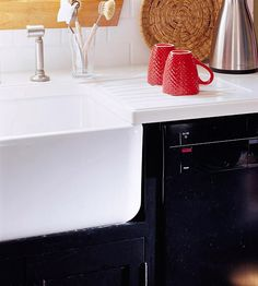 A built-in drain board added to the countertop eliminates the need for a bulky plastic one. Cutting clutter is key to making a small kitchen feel larger.