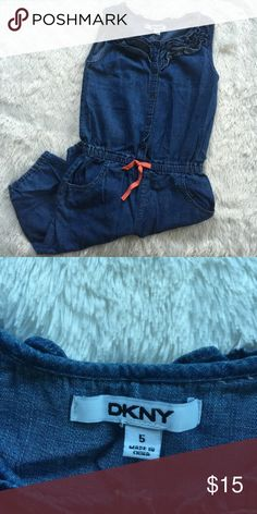 DKNY kids denim jean romper jumpsuit girls 5 NWOT denim romper by DKNY. Ruffles on neck line and buttons on front. Size 5T DKNY Bottoms Jumpsuits & Rompers