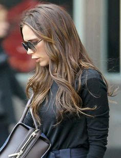 Victoria Beckham hair color. Brown hair with highlights.