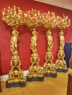 A magnificent suite of four Ormolu floor-standing candelabra. French, Circa 1860-1880