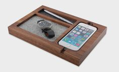 It may not fit the new iPhone we expect to see later today, but for all of us who aren't already waiting outside of an Apple store, this Maple Timber Tray is a stylish way to charge up your 5, 5S, ...