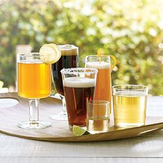 Beer cocktails like shandys and black velvets have made a comeback in bars, but these summer refreshers are just as easy to make at home. Click for recipes!