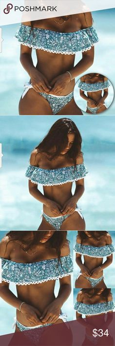 NEW THE ROXANNE TWO PIECE Off shoulder two piece bikini featuring a blue floral design.  Top includes padded bust with standard side tie bikini bottom.  Vacation or beach ready and very feminine.  Bundle your order to save on price or submit your offer.  For Sizing, please refer to size chart.   Tags lingerie, thing, string, bodysuit, pink, one piece, panty, g string, sexy, push up, bra, swimsuit, monokini, bikini, beach, cheeky, off shoulder, floral, Swim