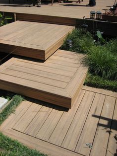 Floating deck squares up to a larger deck create a feeling of movement here. Alternating the direction of the timber planks enhances this sense.