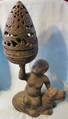 Incense burner, I believe, and VERY cool at that!