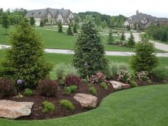 This berm features evergreen screening, boulder accents, and pops of color achieved with blooms and foliage. This berm features evergreen screening, boulder accents, and pops of color achieved with blooms and foliage. Evergreen Landscape, Outdoor Gardens, Landscape Design, Beautiful Yards, Urban Garden, Front Yard Garden, Backyard Landscaping, Backyard, Outdoor Landscaping
