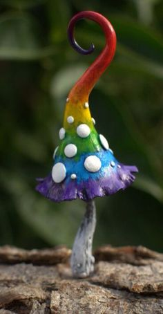 Make a mushroom from clay, let dry then paint for a fairy garden.