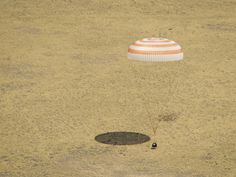 Picture Perfect Landing.  The Soyuz TMA-03M spacecraft is seen as it lands with Expedition 31 Commander Oleg Kononenko of Russia and Flight Engineers Don Pettit of NASA and Andre Kuipers of the European Space Agency in a remote area near the town of Zhezkazgan, Kazakhstan, on Sunday, July 1, 2012.