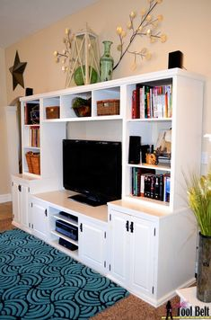 How to build a Pottery Barn inspired media center with toy storage, Her Tool Belt on Remodelaholic.com