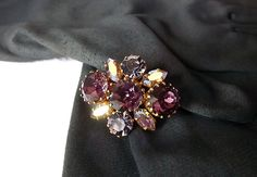 1940s French brooch with amethyst tone and aurora by MaisonMaudie, $18.00