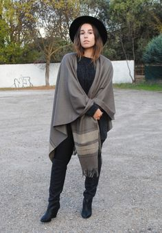 Stay stylish on busy days in a charcoal knit oversized sweater and black leggings. Elevate your getup with black leather knee high boots.  Shop this look for $106:  http://lookastic.com/women/looks/hat-leggings-knee-high-boots-oversized-sweater-shawl/5739  — Black Wool Hat  — Black Leggings  — Black Leather Knee High Boots  — Charcoal Knit Oversized Sweater  — Grey Shawl