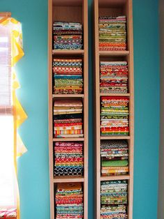 Fabric storage using IKEA cd/dvd towers.