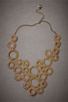 Love this hand-crocheted bib necklace! Would look great on a bare neck, peeking out of a crisp, white shirt, or really cool over a slim black turtleneck.