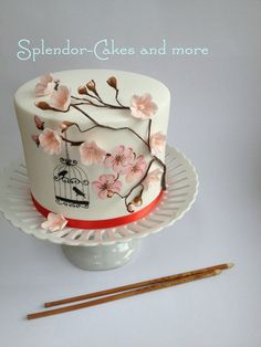 This cake was hugely inspired by the work of Erin from Three Little Blackbirds (TLB Cakes). After watching her fabulous free mini class on Craftsy I went about to find a project to do. While researching cherry blossoms, I came across a fantastic handpainted cherry blossom cake by Môn Cottage Cupcakes. When I contacted Nina to rave about her stunning cake, she sent me her handpainted cherry blossom tutorial.