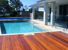 Pool surrounds on pinterest pools rectangle pool and for Swimming pool surrounds design