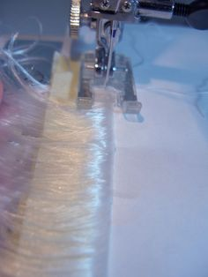 Instructions to make wig wefts from loose hair fibers. Method makes a very narrow & discreet sewn weft.