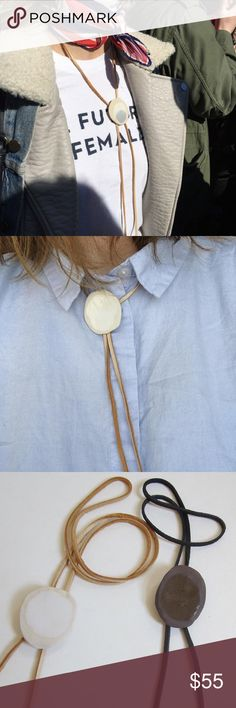 "Bolo Tie Two Hands Full Ceramic bolo tie strung on Deerskin lace, finished with silver fastenings on the back to hold lace in place.   Measures about 1.5"" in diameter and hangs 16"" long from top.  Each wheel-thrown piece is one of a kind and made with heart at my studio in Boulder, Colorado. Because of this, measurements are approximate and there may be slight variations in glaze.   Also keep in mind that these pieces are somewhat delicate, as with anything special. In dark color only…"