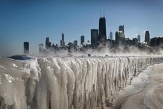 A frozen Lake Michigan in front of the Chicago skyline, As wind chill temperatures in Chicago dropped as low as degrees Farenheit on Wednesday, according to the National Weather Service, parts of Lake Michigan turned to ice. Lago Michigan, Lake Michigan Frozen, American Falls, Chicago River, National Mall, National Weather, Chicago Skyline, Skyline Art, Before Sunrise