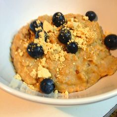 Peanut Butter banana oatmeal   1/2 cup old fashion oats 1 cup of unsweetened almond milk 2 tbsp + tsp of PB2 (tsp for topping) 1/2 banana (mashed) 1 tbsp of oat bran 1/2 tsp of flax seed blue berries for topping Sprinkle of Sugar free substitute( I used truvia)   Bring all ingredients to a boil rather than blueberries and tsp of PB2. Stir frequently. Cook for 5-6 min Enjoy!
