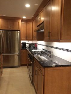 """Coffee maker and toaster oven in the """"breakfast area"""" to the right of the fridge. Readily accessible, but out of the way."""