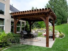 Free standing pergola with Early American stain and Champion profile.