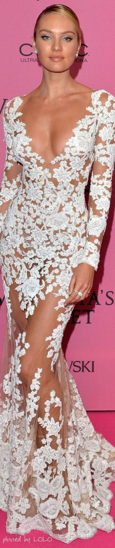 Candice Swanepoel wearing a revealing Zuhair Murad white floral embroidered sheer long-sleeve gown