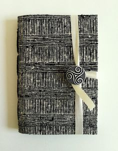 Black and White fabric Notebook / journal / diary, Designed to open with a swirly spiral black and white button and white sattin ribbon