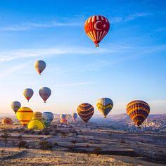 Discovered by Brian Thio at Ortahisar, Ortahisar, Turkey - as the sun rises over #cappadocia #turkey brilliantly colored hot air balloons begin to drift across the sky...